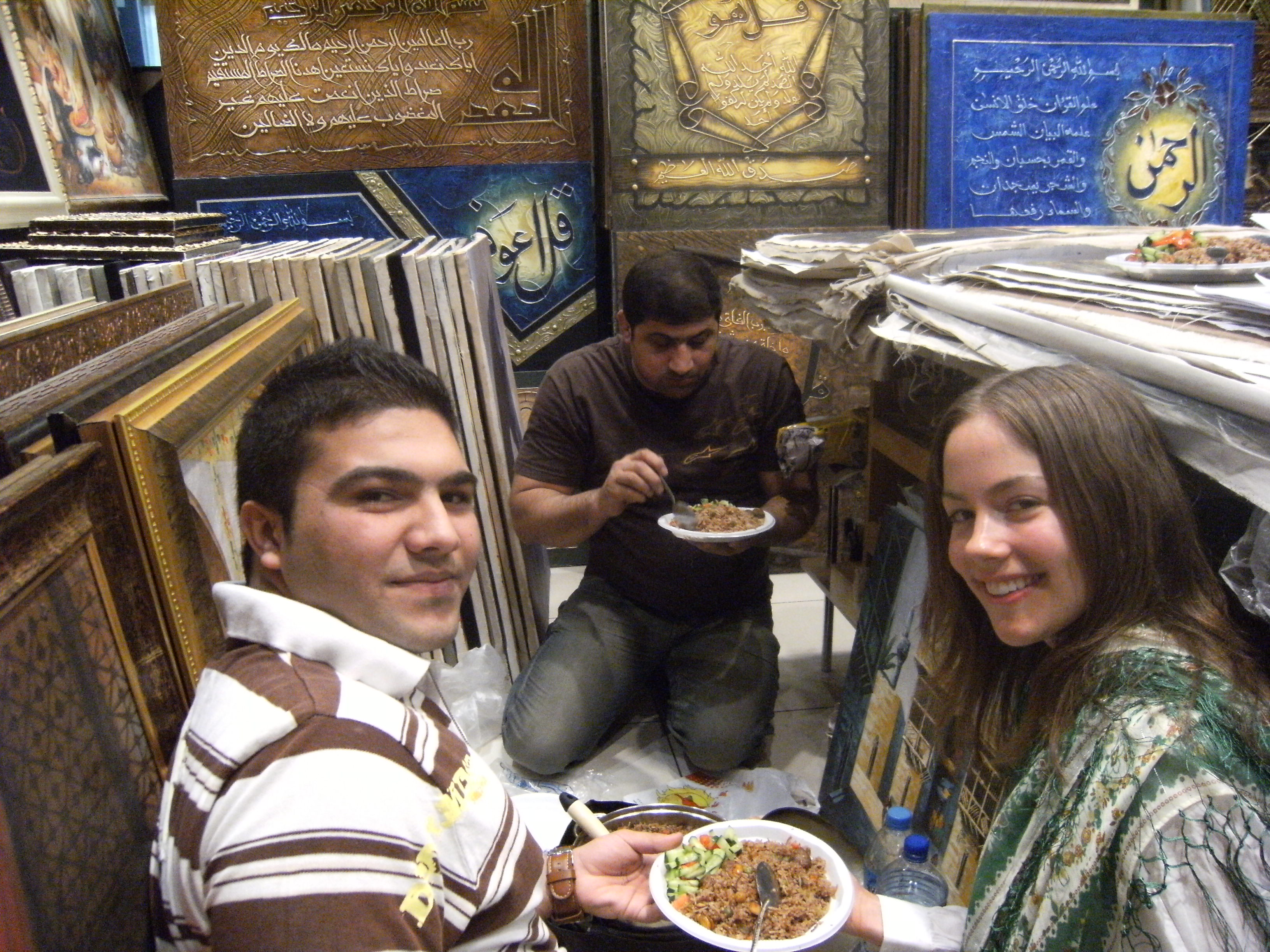 Rachael Stovall enjoying a meal with locals in Jordan, 2009